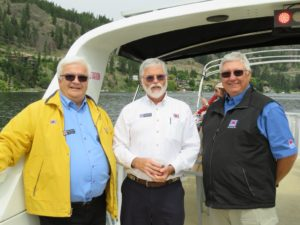 Chief Commander Robert Pepin, District MembershipOfficer Doug Stewart, and Okanagan Squadron Commander Howard Sures  enjoying a cruise on the Okanagan.